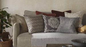 a selection of cushions on a sofa for interiors features