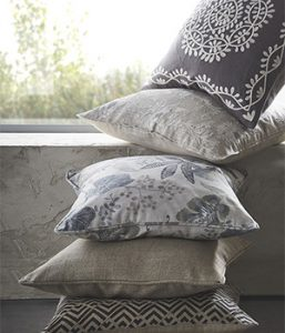 a stack of decorative cushions for interiors feature